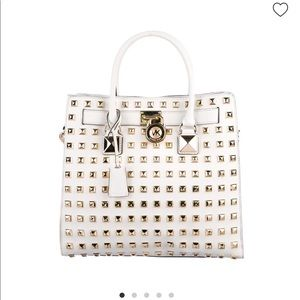 White purse with gold studs